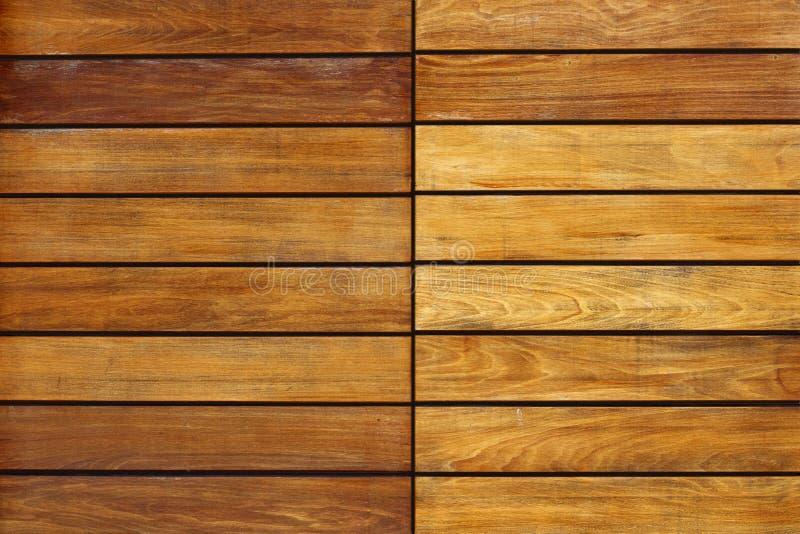 Golden wood stripes door pattern background. Wooden texture royalty free stock image