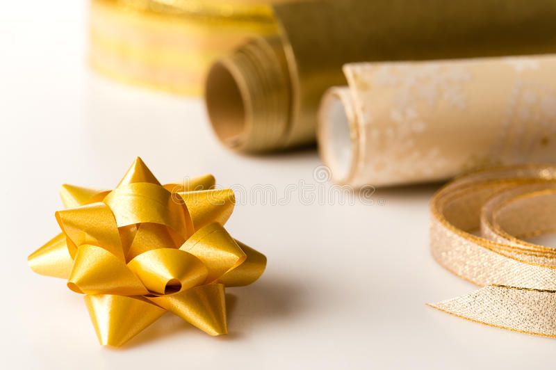 Golden wrapping paper and bow present decoration stock image