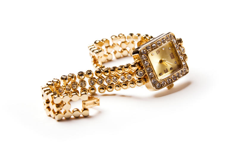 Golden wristwatch with gems. Isolated over white royalty free stock photo