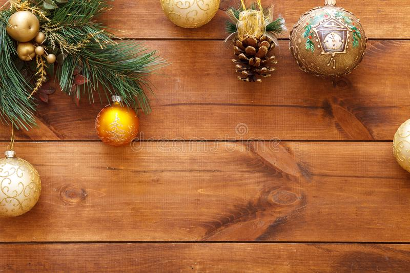 Xmas balls on merry Christmas tree, happy new year card decoration on brown wooden background, top view, copy space stock photo