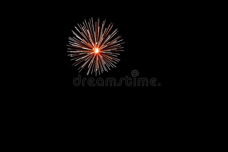 Golden yellow fireworks on an isolated black background for design decoration of holidays, the new year, as well as independence d stock image