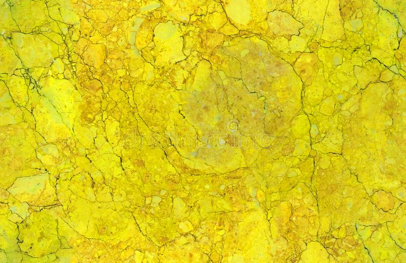 Golden yellow natural seamless granite marble stone texture pattern background. Rough natural stone seamless marble texture surfac royalty free stock images