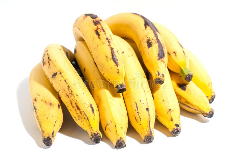 Golden yellow ripped banana with some stains on white b stock photos