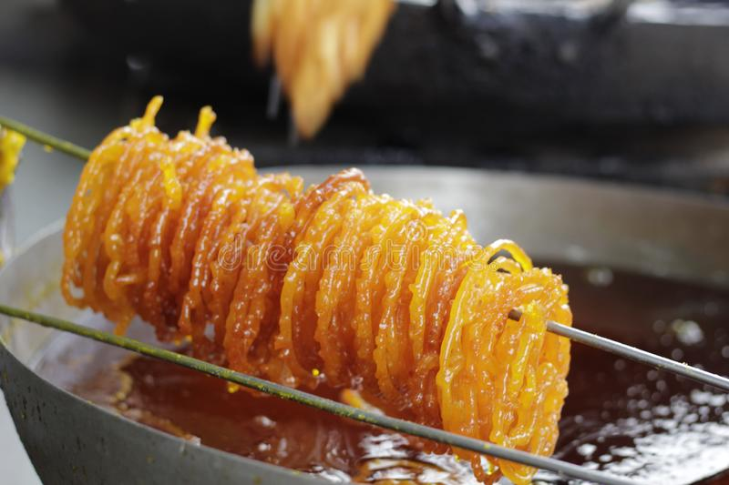 Golden yellow sweet dish relished in India royalty free stock photography