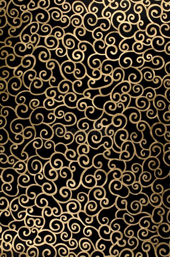 Goldene abstrakte Arabeske lizenzfreie stockfotos