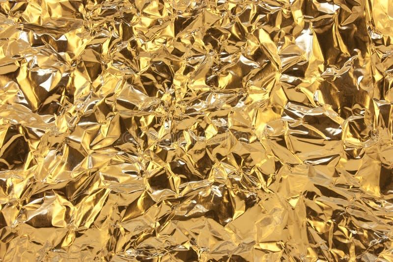Goldene Folie stockbilder