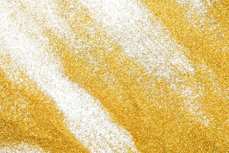 Goldene Funkelnsandbeschaffenheit auf weißem, abstraktem Hintergrund stockbild