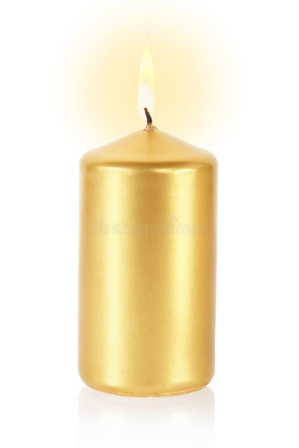 Goldene Kerze auf Weiß stockbild