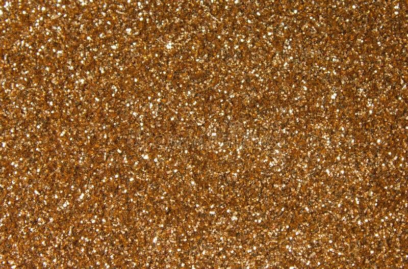 Goldene Paillette - funkelndes paillettenbesetztes Gewebe lizenzfreie stockbilder