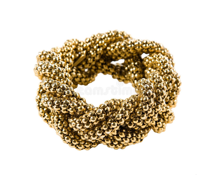 Umsponnenes Kettenarmband der goldenen Perlen stockfotografie