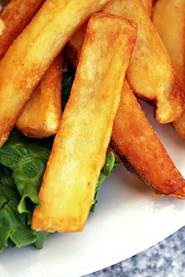 Goldene Pommes-Frites lizenzfreies stockbild