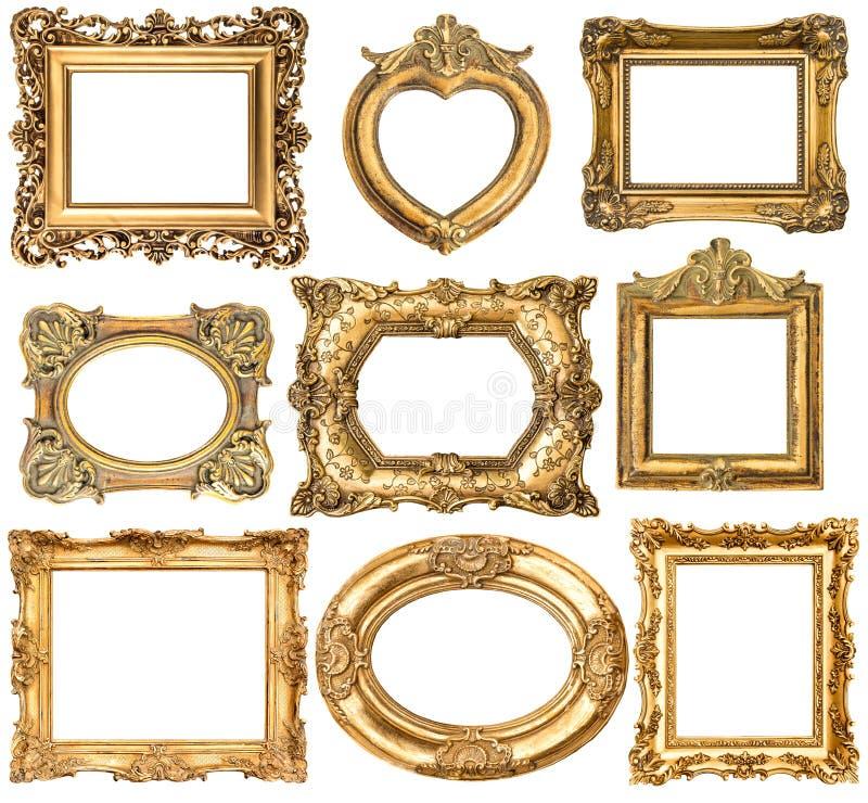 Goldene Rahmen ohne die Schatten lokalisiert auf weißem Hintergrund lizenzfreie stockfotos