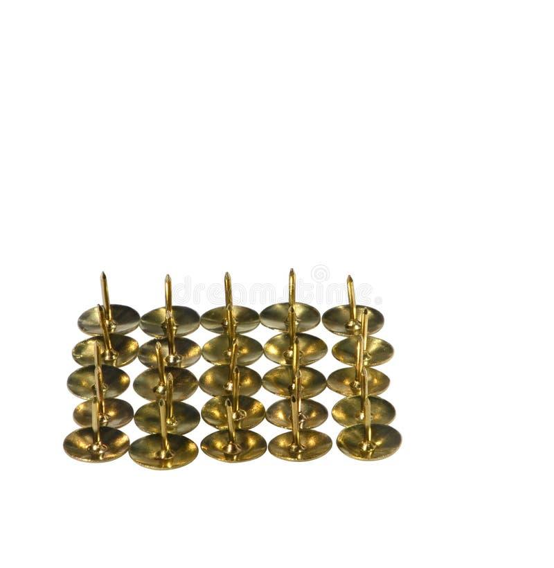 Goldene Reißnadeln stockbilder