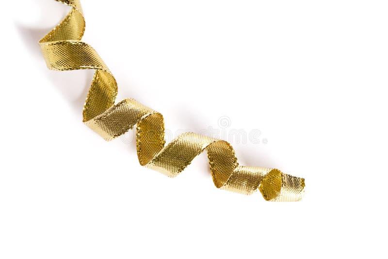 Goldene Rotationfarbbänder auf weißem Hintergrund lizenzfreies stockbild