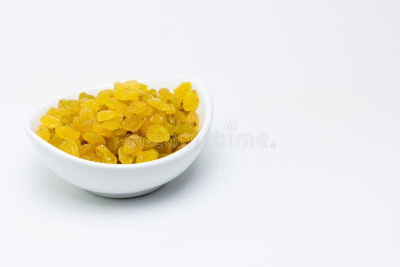 Goldene samenlose Rosinen der Schüssel lizenzfreies stockbild