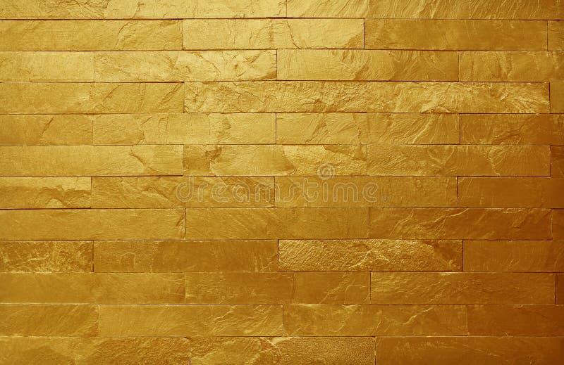 Goldene Schiefersteinwandbeschaffenheit im natürlichen Muster mit hoher Auflösung für Hintergrund- und Entwurfskunstwerk lizenzfreie stockfotografie