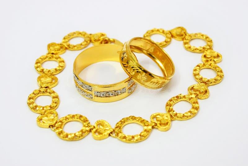 Goldene Schmucksachen stockfotos