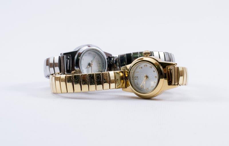 Goldene und silberne Uhren stockfotos