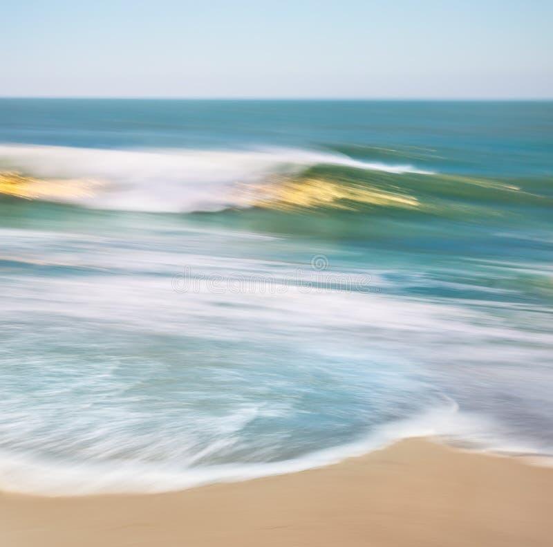 Goldene Wellen-Unschärfe stockfoto