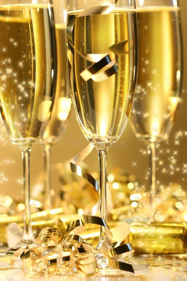 Goldener Champagnerschein stockbild