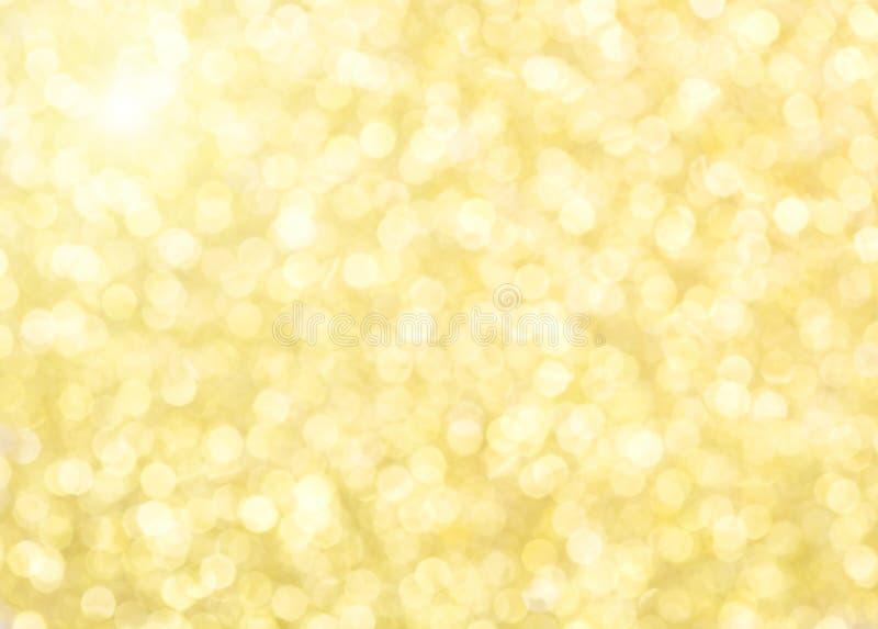 Goldener Funkelnhintergrund stockfoto
