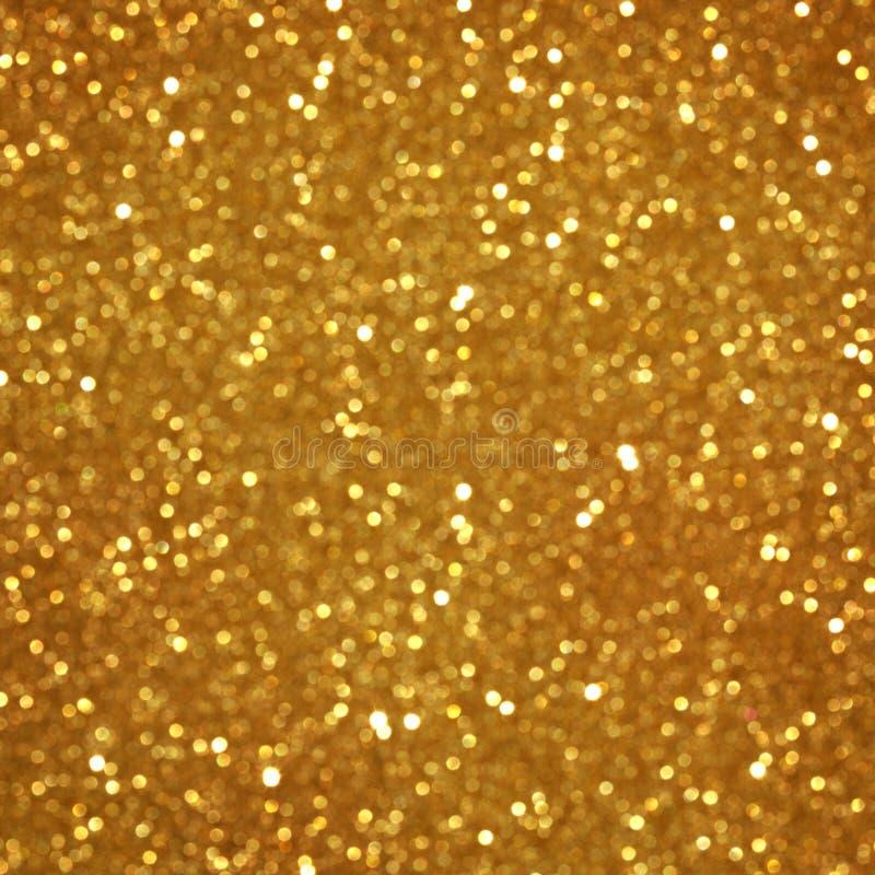 Goldener Funkelnweihnachtshintergrund