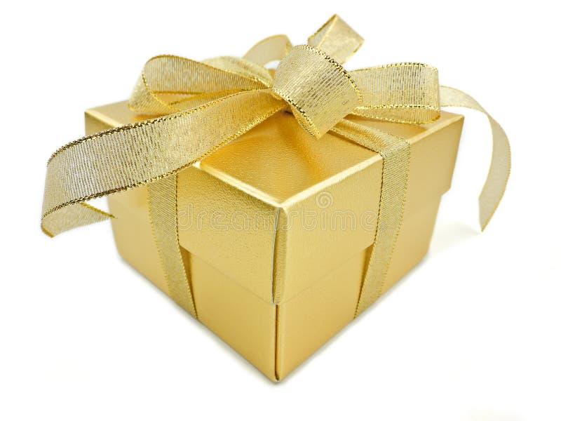 Goldener Geschenkkasten stockbilder