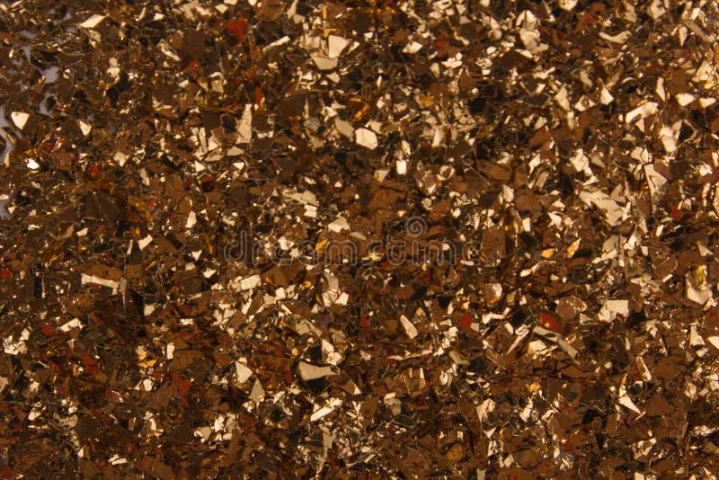 Goldener Glaskörnchenhintergrund lizenzfreie stockbilder