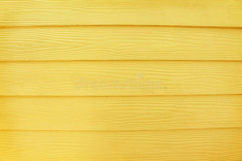 Goldener hölzerner Wandmusterhintergrund in horizontalem lizenzfreie stockfotografie
