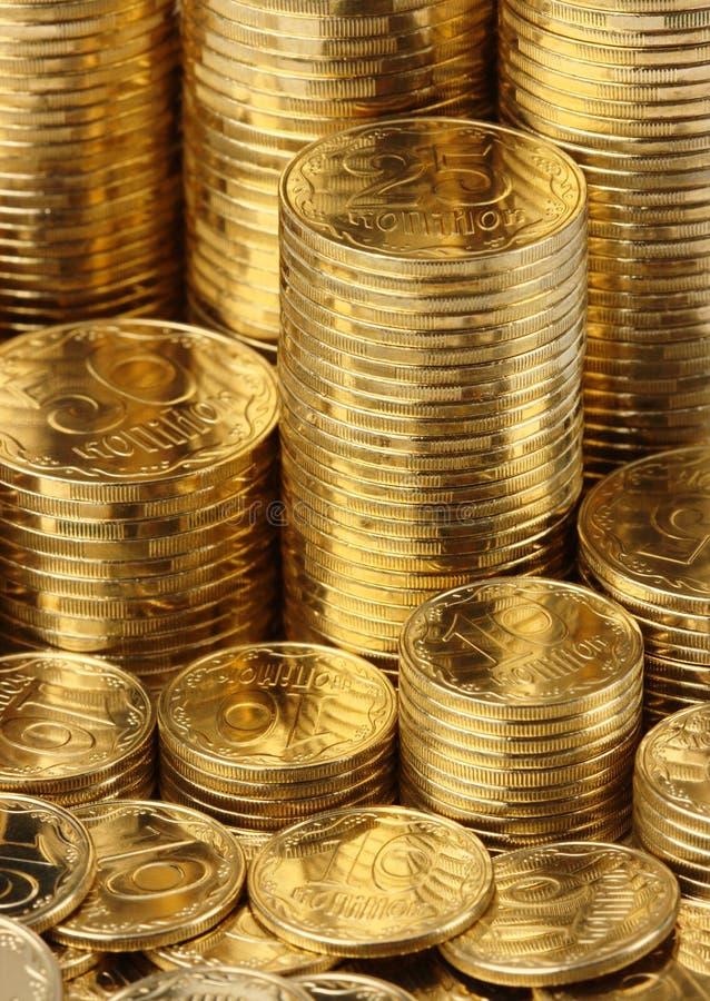 Goldener Münzenhintergrund stockfoto