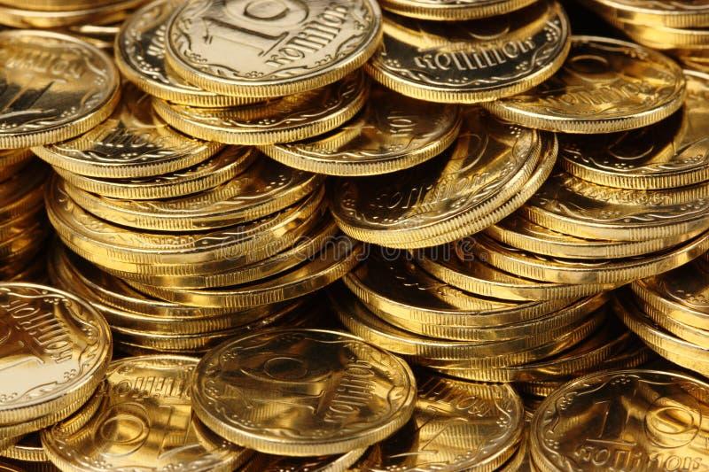 Goldener Münzenhintergrund stockbilder