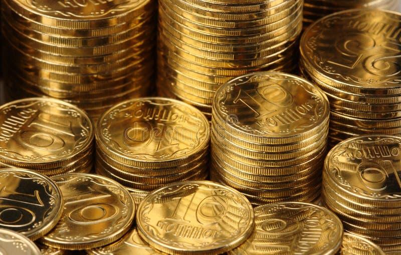 Goldener Münzenhintergrund lizenzfreie stockfotos