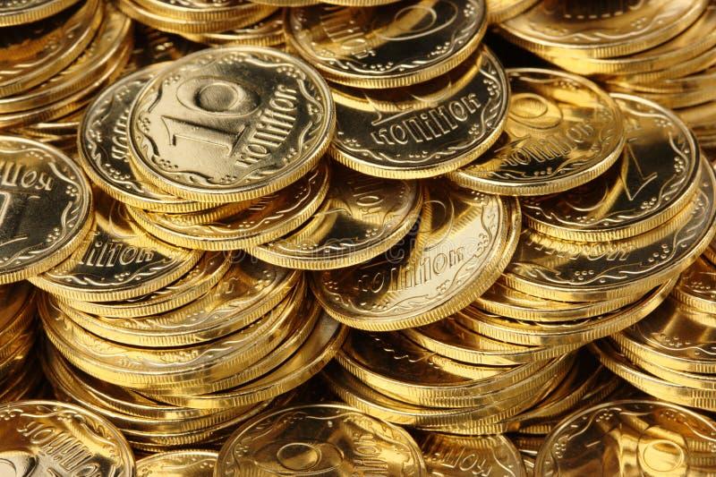 Goldener Münzenhintergrund stockbild