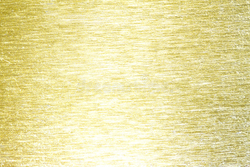 Goldener Metallmessing verkratzte Hintergrundbeschaffenheit lizenzfreie stockfotos