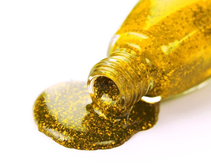 Goldener Nagellack stockbild