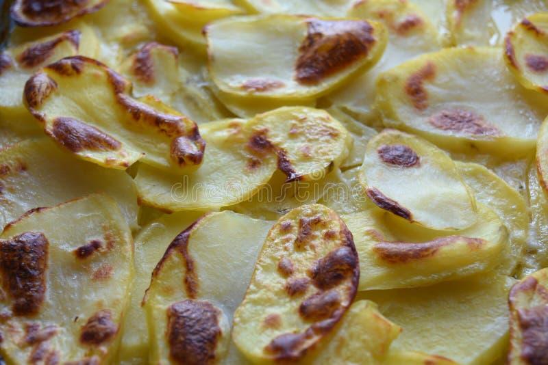 Goldener Owen Roasted Potato Slices lizenzfreies stockbild