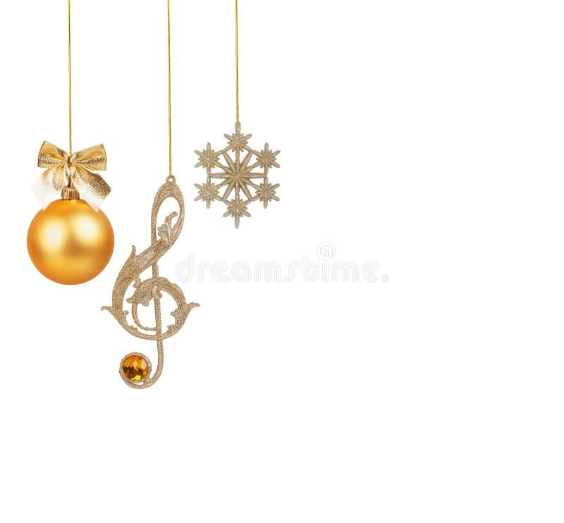 Goldener Violinschlüssel, Schneeflocke und Weihnachtsball lizenzfreies stockfoto