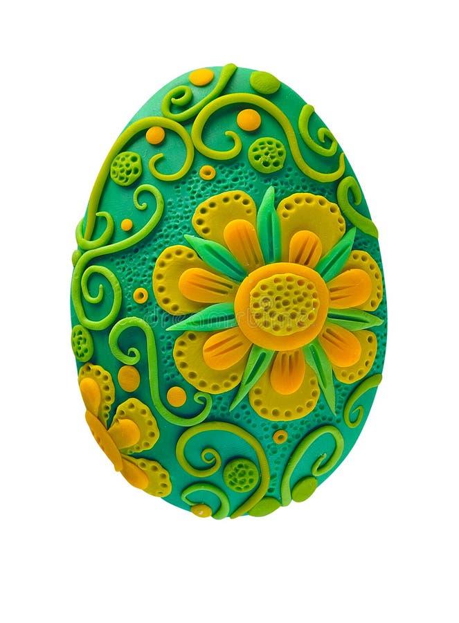 Goldenes Ei über grünem Steigungshintergrund stock abbildung