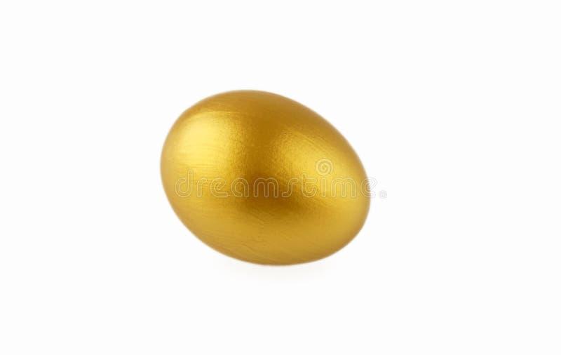Goldenes Ei lizenzfreie stockbilder