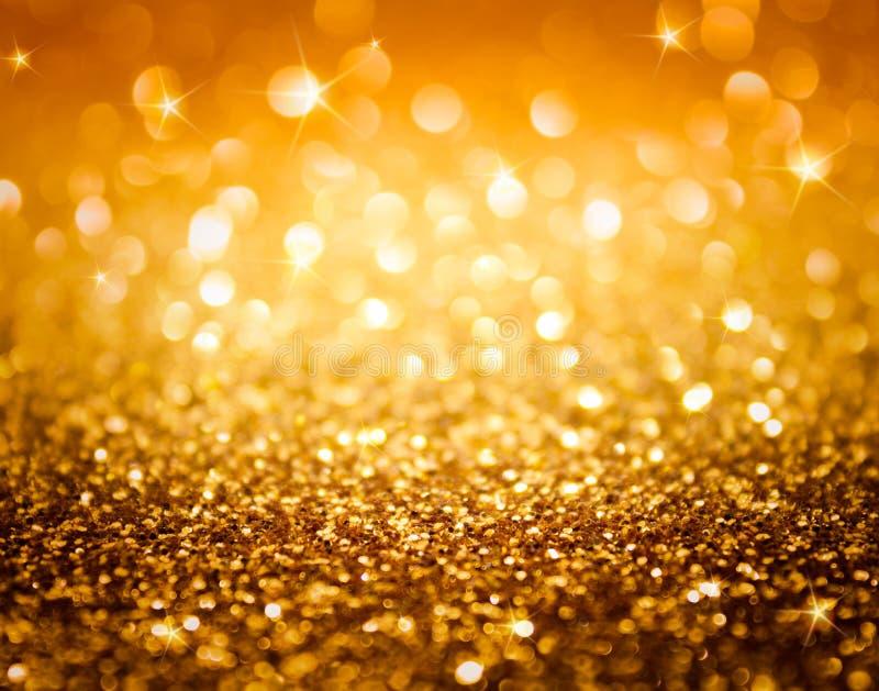 Goldenes Funkeln und Sterne für Weihnachtshintergrund