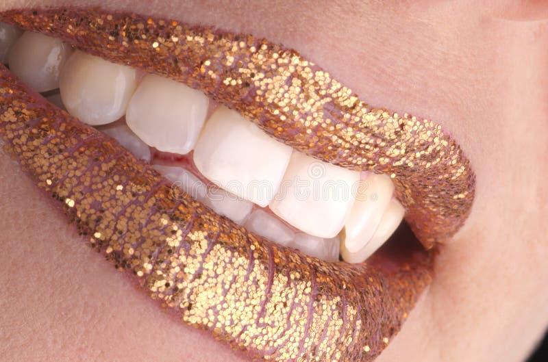 Goldenes Lächeln stockbilder