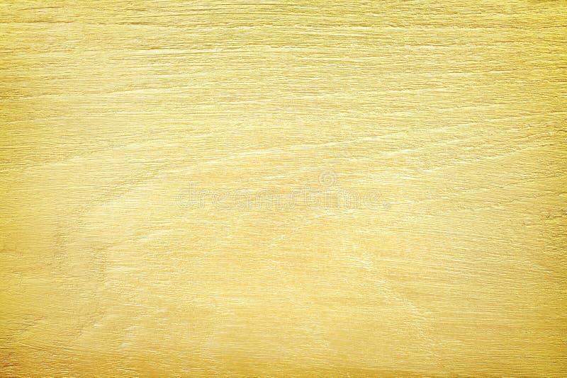 Goldfarbe auf hölzerner Wandbeschaffenheit für Hintergrund stockbilder