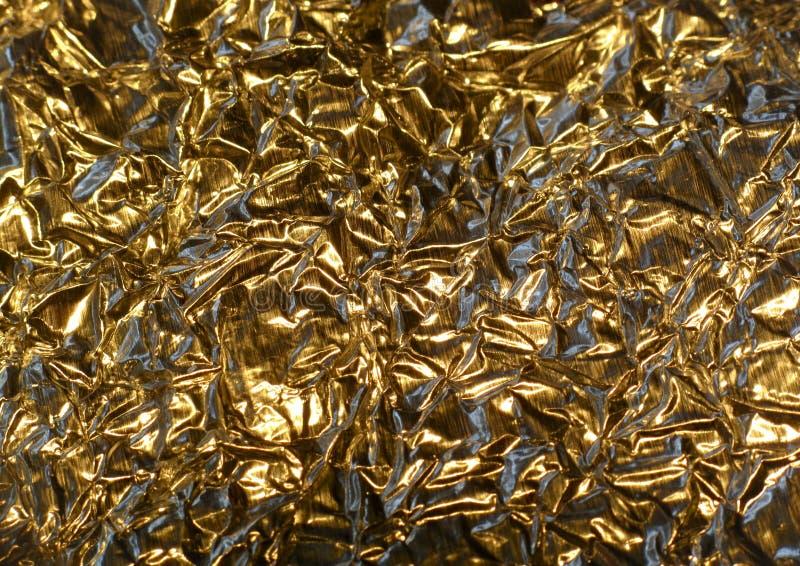 Goldfarben-Aluminiumfolie stockbilder