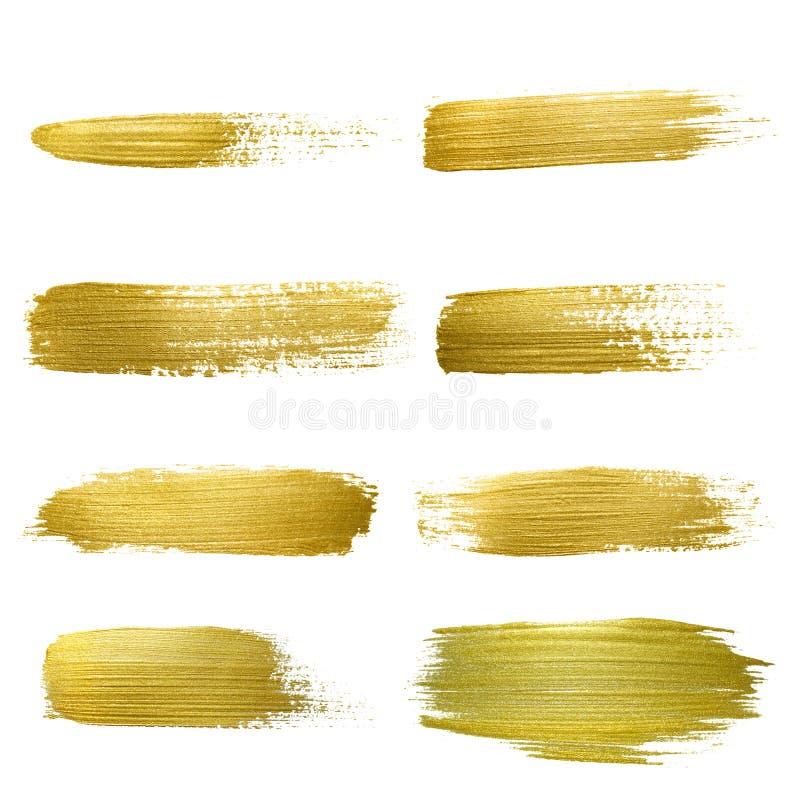 Goldfarbenabstrichanschlag-Flecksatz stockfotos