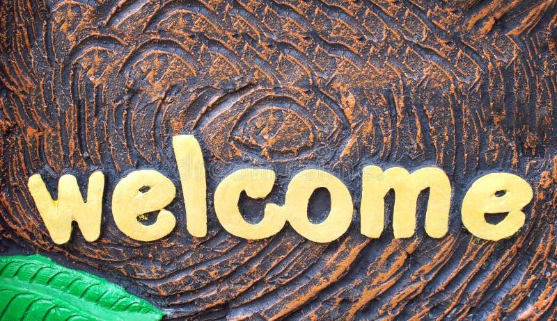 Goldfarbenalphabet-Willkommensschildmuster abstrakt auf Hintergrund lizenzfreies stockfoto