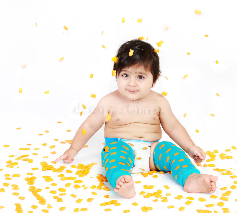 Goldfish. Baby wearing a legging with goldfish pattern and raining goldfish royalty free stock photography