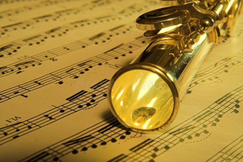 Goldflöte-Musikhintergrund lizenzfreies stockfoto