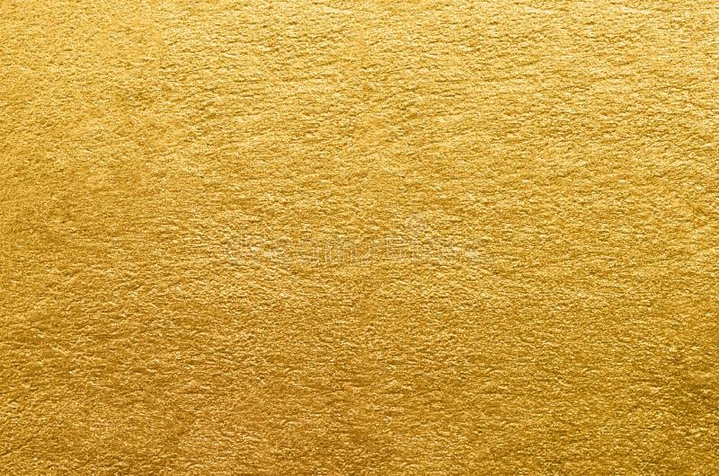 Goldfolienbeschaffenheit Goldener abstrakter Hintergrund lizenzfreies stockbild
