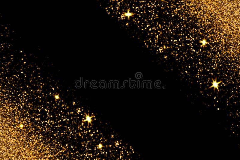 Goldfunkeln mit dem Glühen funkt auf schwarzem Hintergrund stockbilder