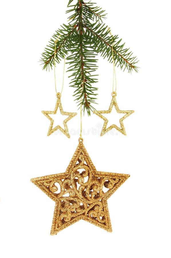 Goldfunkeln Weihnachten spielt das Hängen von einem Baum die Hauptrolle lizenzfreies stockfoto